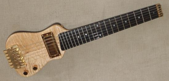 left handed travel guitars lap axe. Black Bedroom Furniture Sets. Home Design Ideas