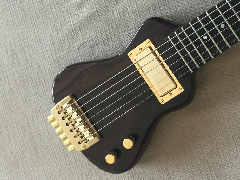 travel guitar reviews lap axe. Black Bedroom Furniture Sets. Home Design Ideas